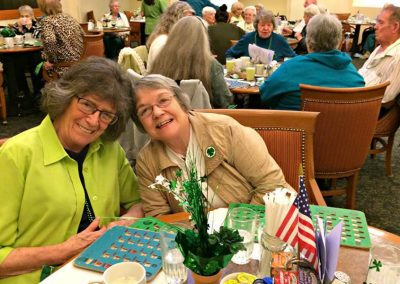 Residents playing bingo at one of Mosaic Management's Communities
